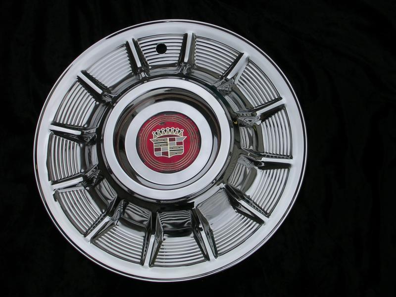 57 Cadillac Hubcap